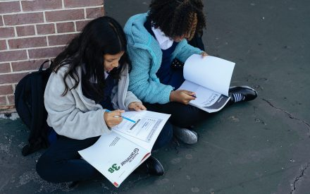 two teenage girls doing their homework together