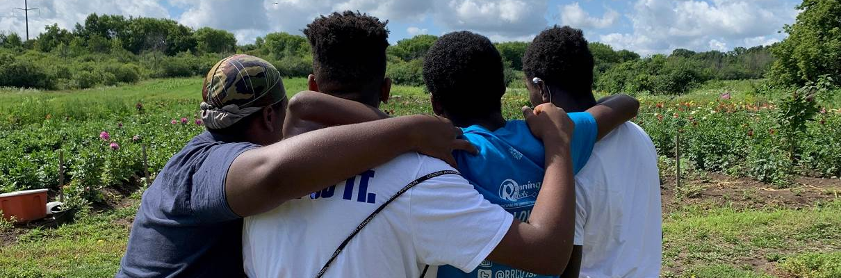 Youth participants looking over the farm